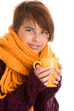 Young woman drinking hot chocolate Royalty Free Stock Photos