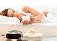 Woman with mug of cafe in  bed Stock Image