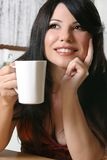 Woman with a mug of coffee Stock Photos