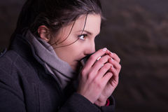 Woman with mug of hot drink during cold day Royalty Free Stock Photography