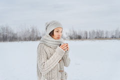Woman with mug outdoors Royalty Free Stock Image