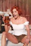 Woman with mug and pretzel Stock Photo