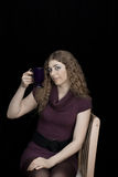 Woman with mug of tea/coffee stock image