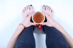 Woman with a mug of tea Stock Image