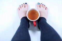 Woman with a mug of tea Royalty Free Stock Photos