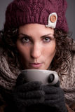 Woman with a mugful of a hot drink Stock Photo