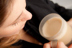 Woman with a muk of coffee Stock Image