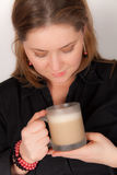 Woman with a muk of hot coffee Royalty Free Stock Images