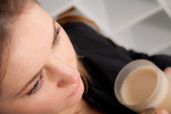 Woman with a muk of hot coffee Royalty Free Stock Photo
