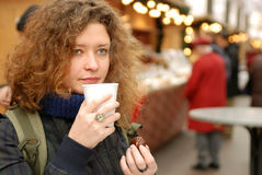 Woman with mulled wine at christmass fair Stock Image