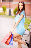 Woman with multi-colored packages Royalty Free Stock Photography