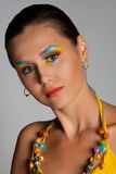 Woman and multicolored make-up. Royalty Free Stock Photography