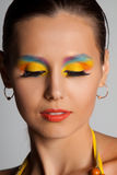 Woman and multicolored make-up. Stock Photos