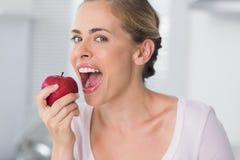 Woman munching apple Royalty Free Stock Photography
