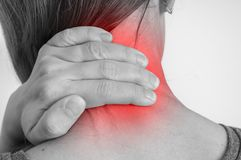 Woman with muscle injury having pain in her neck. Black and white photo Stock Images