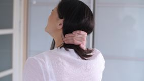 Woman has neck pain. Woman with muscle injury having pain in her neck stock video footage