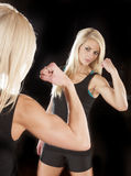 Woman muscle mirror look Royalty Free Stock Photography