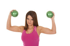 Woman muscles green balls Royalty Free Stock Image