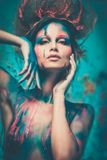 Woman muse with body art. Young woman muse with creative body art and hairdo Royalty Free Stock Images