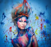 Woman muse with body art. Young woman muse with creative body art and hairdo Stock Photos