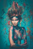Woman muse with body art. Young woman muse with creative body art and hairdo Royalty Free Stock Photography