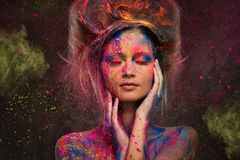 Woman muse with body art. Young woman muse with creative body art and hairdo Royalty Free Stock Photo