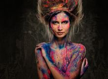 Woman muse with body art. Young woman muse with creative body art and hairdo Stock Images