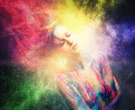 Woman muse with creative body art. And hairdo in colourful powder explosion Royalty Free Stock Image