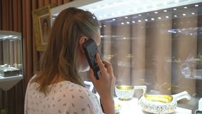 Woman in museum. Woman in museum with handheld audio guide device stock video footage