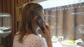 Woman in museum. Woman in museum with handheld audio guide device stock video