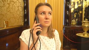 Woman in museum. Woman in museum with handheld audio guide device stock footage