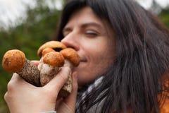 Woman with mushrooms Stock Photos