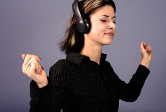 Woman and Music. A portrait of a young woman listening to music stock photography
