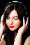 Woman and music Stock Image