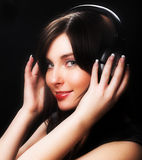Woman and music Stock Images