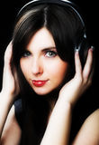 Woman and music. Over black background Stock Photography