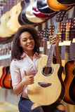 Woman in musical shop Stock Photo