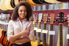 Woman in musical shop Royalty Free Stock Photos