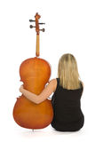 Woman musician with cello. A woman with a cello musician sits with his back to camera Stock Photos