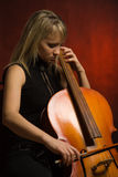 Woman musician with cello Stock Photo