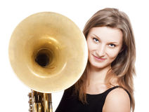 Woman musician with french horn. Young female musician with concert french horn in black dress Royalty Free Stock Images