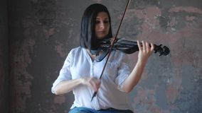 Woman musician performs with a modern electro-violin. Woman musician performs with modern electro-violin stock video