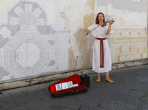 The woman musician playing the violin in florence,italy Royalty Free Stock Images