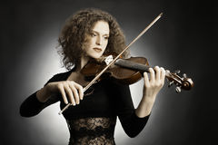 Woman musician playing violin Stock Images