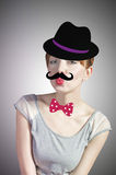 Woman with mustache in a hat Stock Images