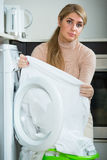 Woman with musty linen after laundry Royalty Free Stock Images