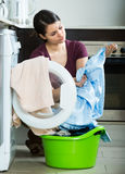 Woman with musty towels Stock Photo