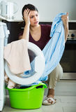 Woman with musty towels Royalty Free Stock Photos