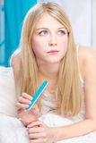 Woman with nail file in bedroom Stock Photo