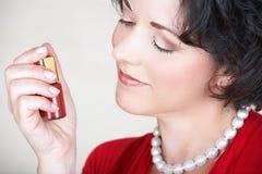 Woman and nail polish Stock Images